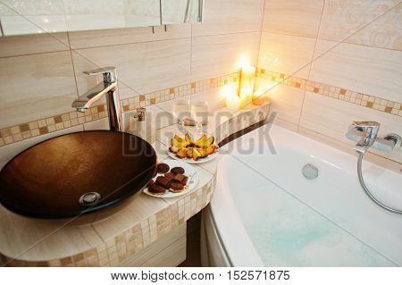 Modern Washbasin In Bathroom With Burning Candles