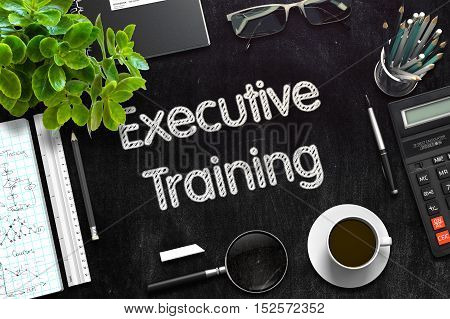 Business Concept - Executive Training Handwritten on Black Chalkboard. Top View Composition with Chalkboard and Office Supplies on Office Desk. 3d Rendering. Toned Image.
