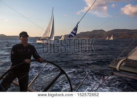 MILOS, GREECE - SEP 27, 2016: Sailors participate in sailing regatta 16th Ellada Autumn 2016 among Greek island group in the Aegean Sea, in Cyclades and Saronic Gulf.