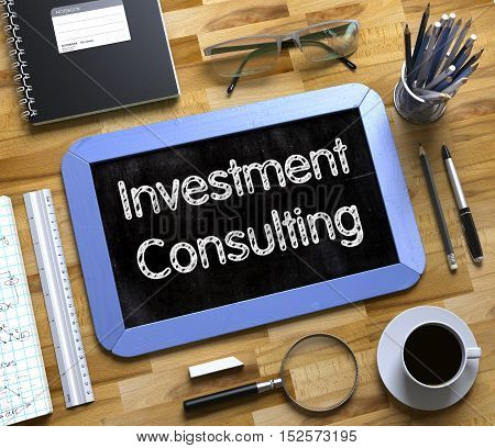 Investment Consulting on Small Chalkboard. Investment Consulting Handwritten on Blue Chalkboard. Top View Composition with Small Chalkboard on Working Table with Office Supplies Around. 3d Rendering.