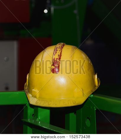 protective one helmet on his head for the builder