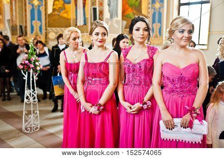 Stylish bridesmaids at the church at wedding