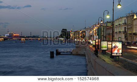 SAINT PETERSBURG RUSSIA - AUGUST 09 2016: August twilight on the English embankment. Tourist landmark of the Saint Petersburg