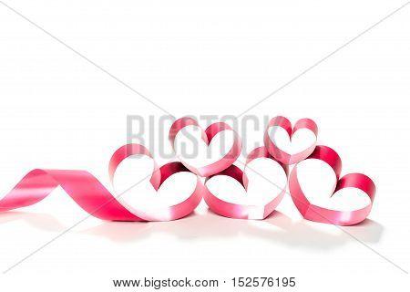 red heart ribbon isolated on white background. studio shot