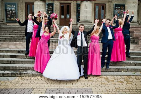 Stylish Groomsmen And Bridesmaids With Wedding Couple