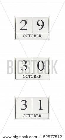 Closeup group of white wooden calendar with black 29 30 31 october word three date calendar isolated on white background