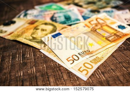 Money from different countries. Dollars euros hryvnia