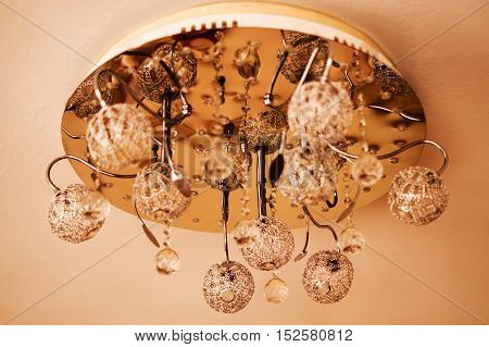 Ceiling chandelier with crystal components used iron components.