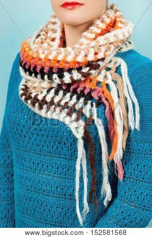 Woolen Scarf. Beige Woolen Scarf Around Her Neck Isolated On Blue Background.