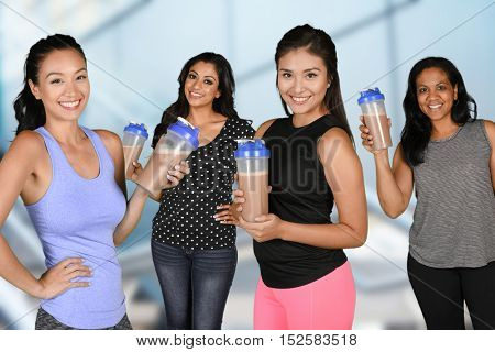 Women drinking a protein shake after their workout