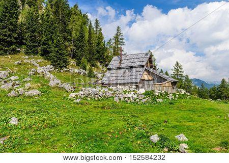 Traditional wooden hut on the mountain, Visevnik planina, tourist destination, Slovenia.