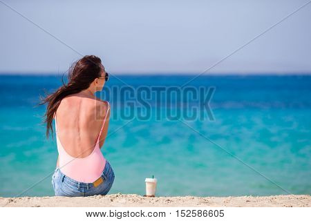 Young beautiful woman on the beach during tropical summer vacation