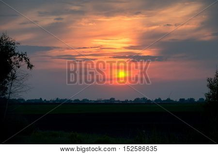 beautiful bright sky with bright clouds in the spring at sunset