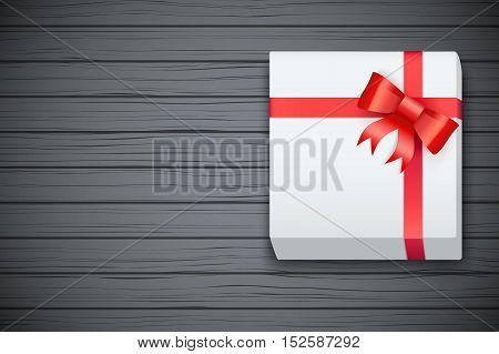 Gift box on black wooden table. Top view. Winter Holiday xmas background and backdrop. Fairy style. Vector Illustration.