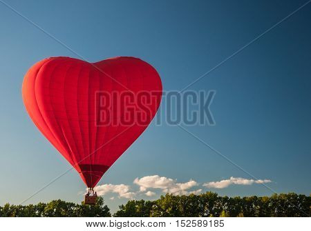 YAKHROMA RUSSIA - JUNE 23 2015: Flight on a balloon in the shape of a heart.