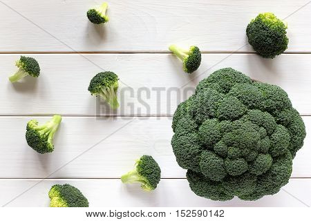 Broccoli And Scattered Pieces On A White Table, Top View.