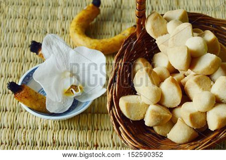Thai Shortbread Cookies or  Kleeb Lamduan is Thai name. Thailand dessert and  fragrant or scented candle used for smoking sweetmeats.