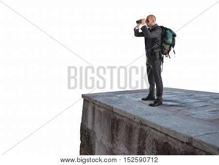 Businessman with backpack and binoculars watching from above