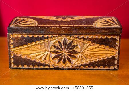 vintage wooden box on the table on a red background