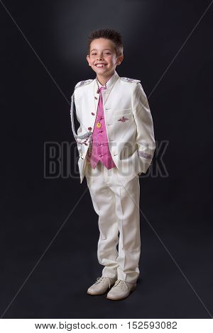 Young Boy Standing And Smiling In His First Holy Communion