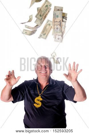 Lucky man, as dollars fall around him isolated on white