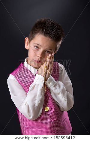 Young Boy Holding His Rosary In His First Holy Communion