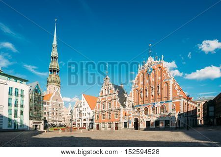 St. Peter's Church And House Of The Blackheads In Riga, Latvia. Sunny Summer Day With Blue Sky. Famous Landmark. Old Architecture. Travel Destination. Nobody. Town Hall Square