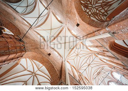 Riga, Latvia - July 1, 2016: The Vaulted Gothic Ceiling Of St. Peter's Evangelical Lutheran Church In Sunlight. The Interior Of Parish Place And Famous Landmark.