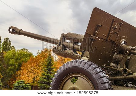 Vintage artillery barrel cannon. Military heavy artillery. Photo with limited depth of field.