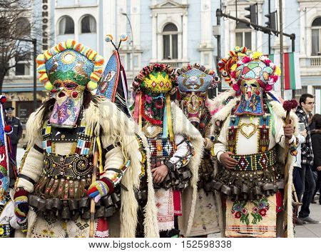 Varna Bulgaria - January 30 2016: Unidentified man in traditional Kukeri costume are seen at the Festival of the Masquerade Games Surva in Varna Bulgaria.