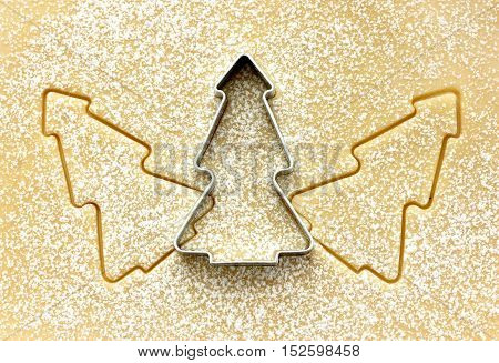 Christmas tree cookie cutter on raw dough. Christmas food preparation background concept