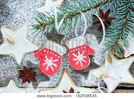 Christmas cookies stars and winter mittens with festive decoration