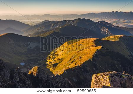 Mountain Landscape at Sunset. View from Mount Dumbier in Low Tatras Slovakia. West Tatras Mountains and Liptovska Mara Dam in Background.