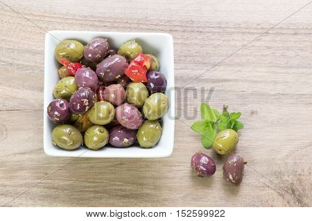 Portion of olives on a wooden table