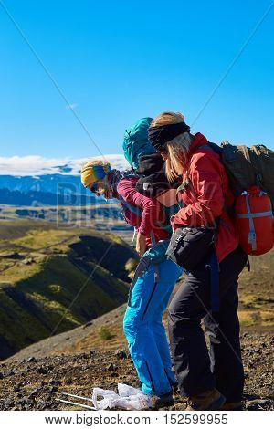woman hikers on the trail, hiking in Iceland