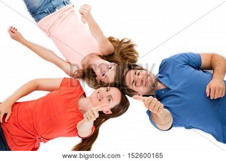 High Angle View Of A Happy Family Lying On White Background And Showing Thumbs Up