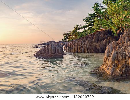 Beautiful seascape. Sea and rock at the sunset. Nature composition. Thai beach in sunset time in Koh Chang island Thailand.