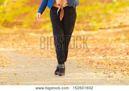 Fashionable Girl Walking In Park.