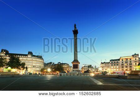 Trafalgar Square with Nelson Column at night, London, UK