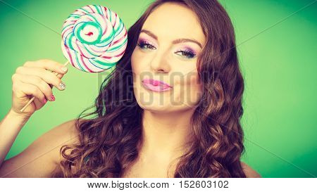 Smiling Girl With Lollipop Candy On Green