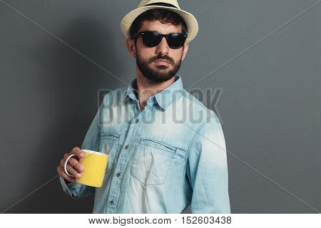 Young Hipster Bearded Man Wearing Hat - Gray Background