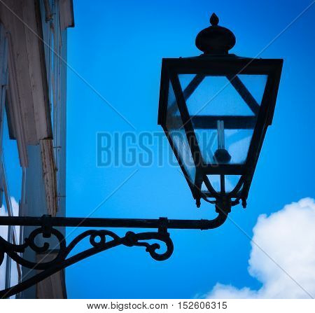 Lamp against the background of the blue sky