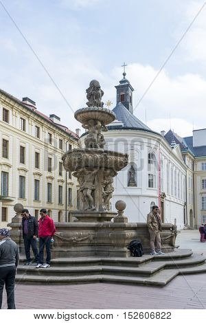 PRAGUE, OCTOBER 15: Tourists in front of a fountain  and Treasury on the Second Courtyard in Prague Castle  on October 15, 2016 in Prague, Czech Republic.