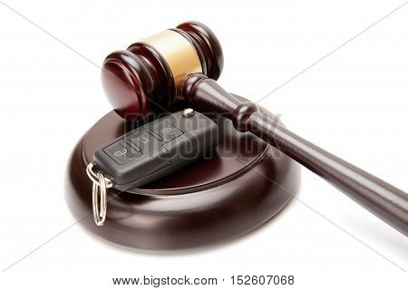 Close Up Of Wooden Judge Gavel And Car Keys Over Soundboard