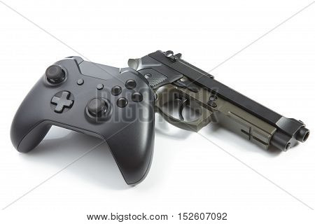 Game Controller And A Real Handgun Near It - Studio Shot. Virtual And Real Life Concept