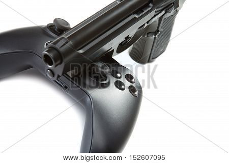 Game Controller And Handgun Near It - Studio Close Up Shot. Virtual And Real Life Concept