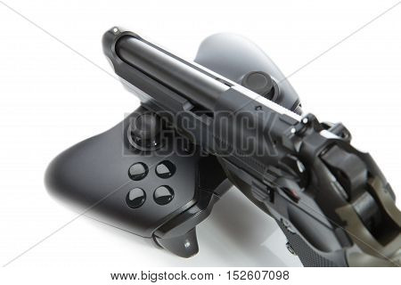 Game Controller And A Real Handgun - Studio Close Up Shot. Virtual And Real Life Concept