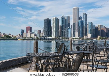 Tables along pier with Chicago skyline in background