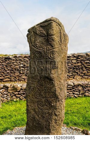 The Ogham Standing stone located at Reask Monastery, County Kerry, Ireland.  Ogham is an alphabet that appears on monumental inscriptions dating from the 4th to the 6th century AD,