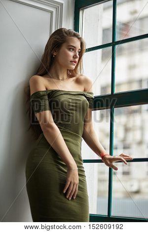 Sexy Caucasian Woman In Dress In Interior